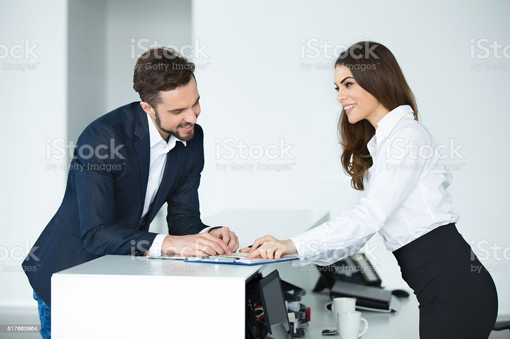 Happy business colleagues going through business reports. stock photo