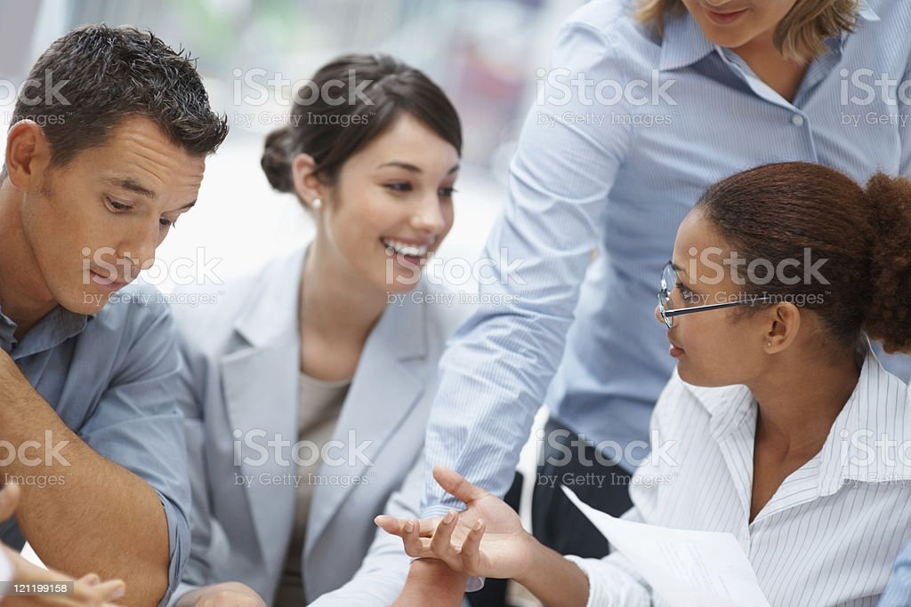 Happy business colleagues having a discussion royalty-free stock photo