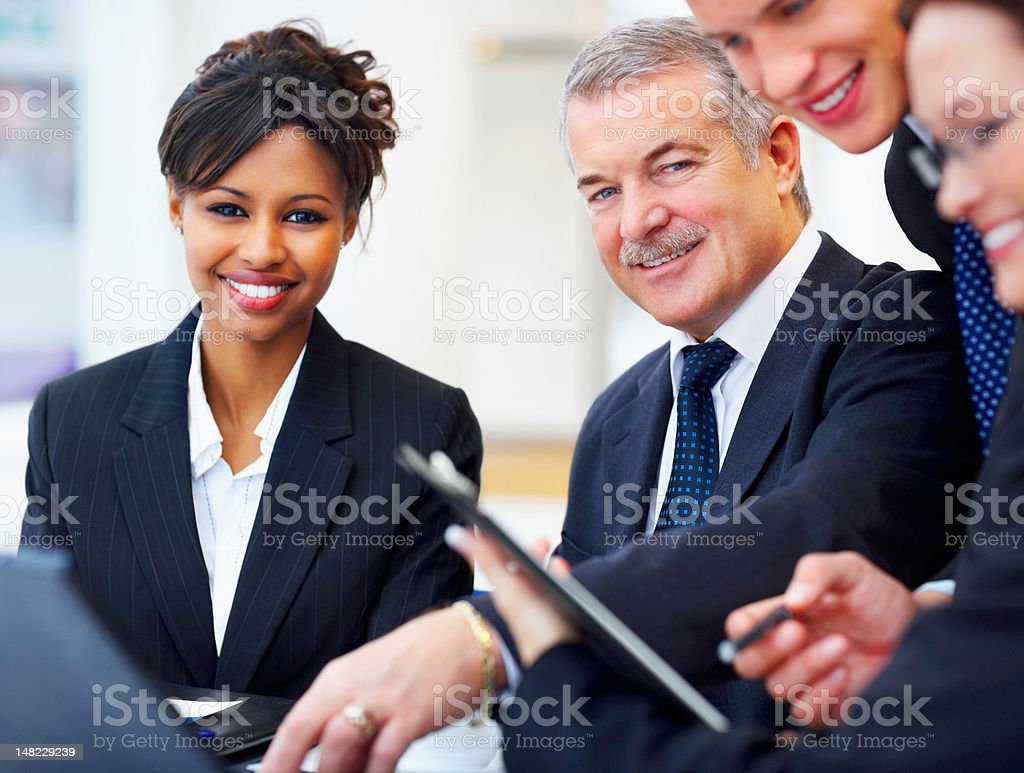 Happy business colleagues in a meeting at office royalty-free stock photo