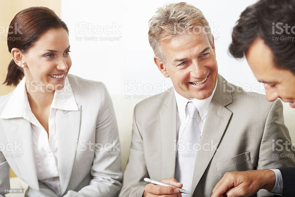 Happy business colleagues in a meeting royalty-free stock photo