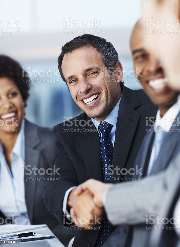 Happy business colleagues shaking hands royalty-free stock photo