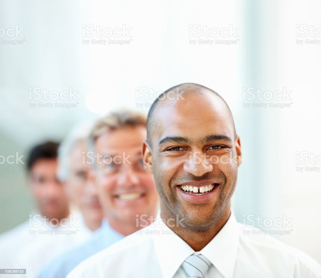 Happy business colleagues standing in a row royalty-free stock photo
