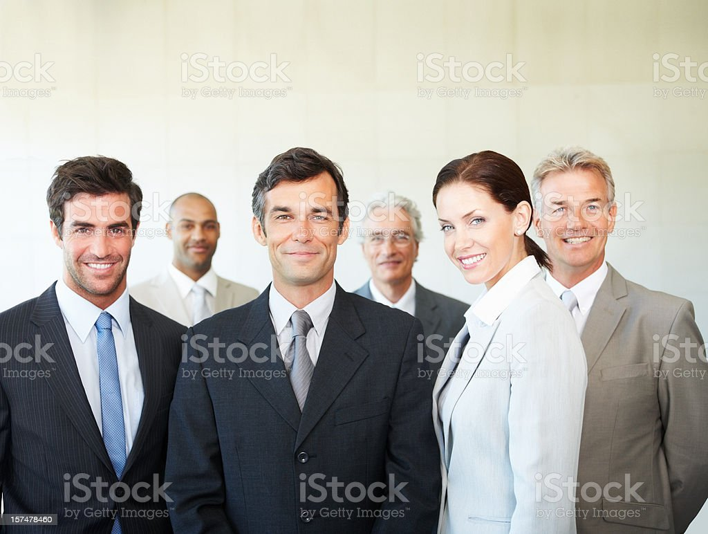 Happy business colleagues standing together royalty-free stock photo