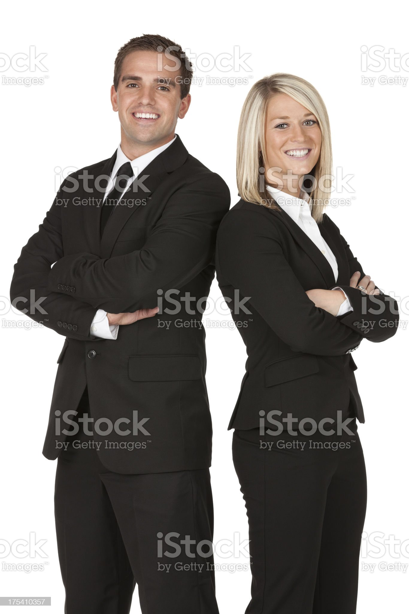 Happy business couple standing with arms crossed royalty-free stock photo