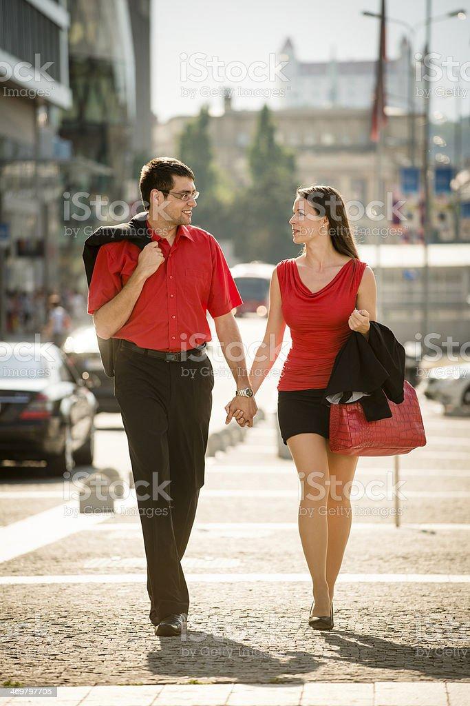 Happy business couple walking street royalty-free stock photo