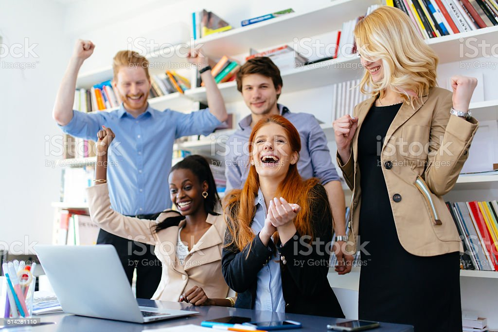 Happy business coworkers celebrating stock photo
