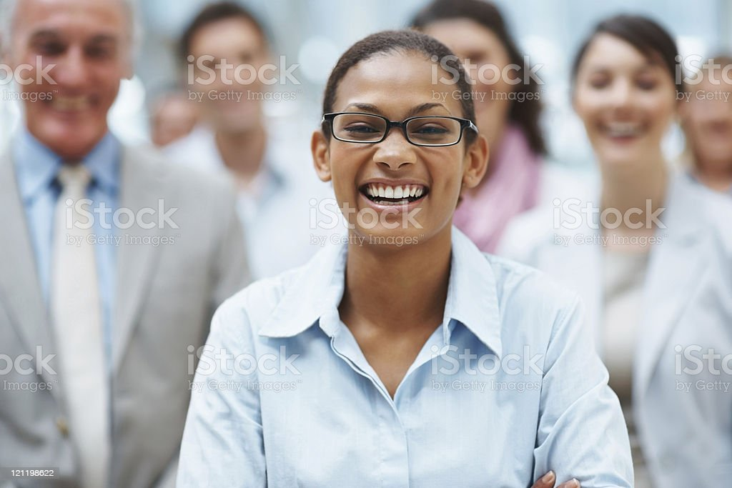 Happy business executive with colleagues at the back royalty-free stock photo