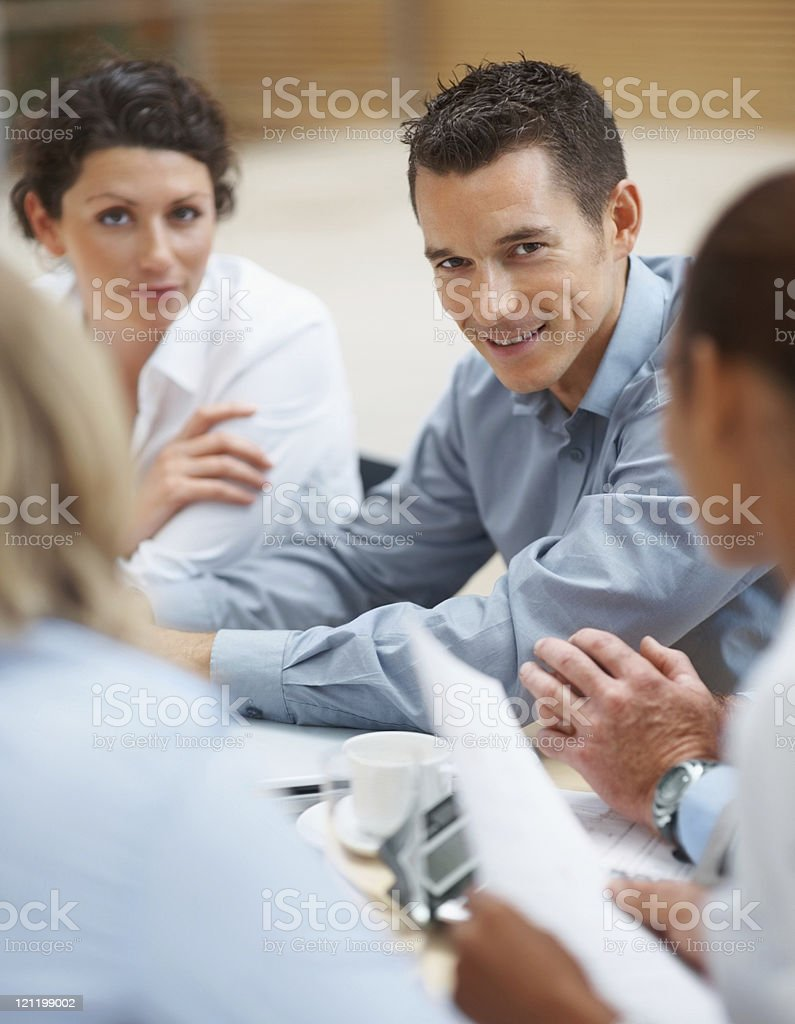 Happy business man at a board room meeting royalty-free stock photo