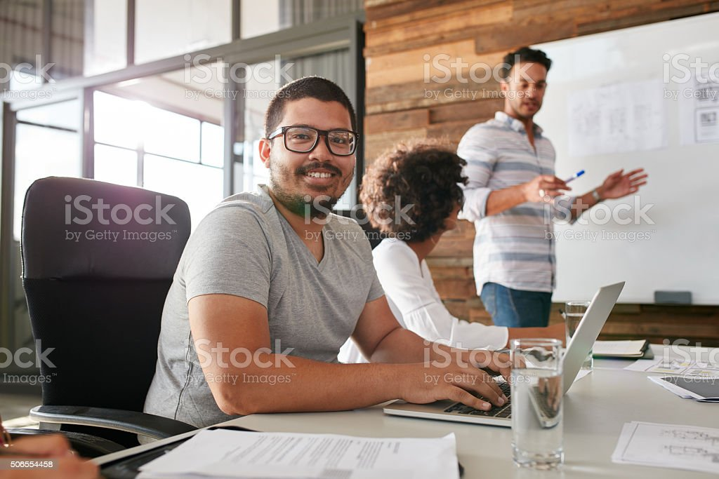 Happy business man at a board room meeting stock photo