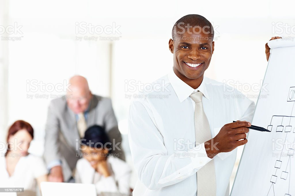 Happy business man giving a presentation at office royalty-free stock photo