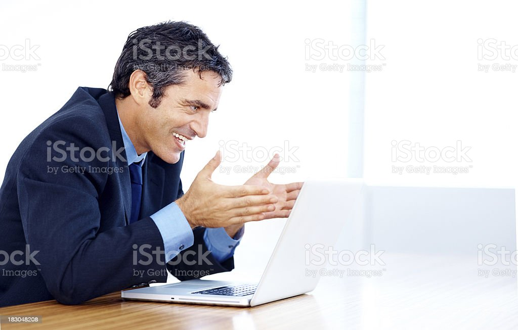 Happy business man looking at laptop screen in boardroom royalty-free stock photo