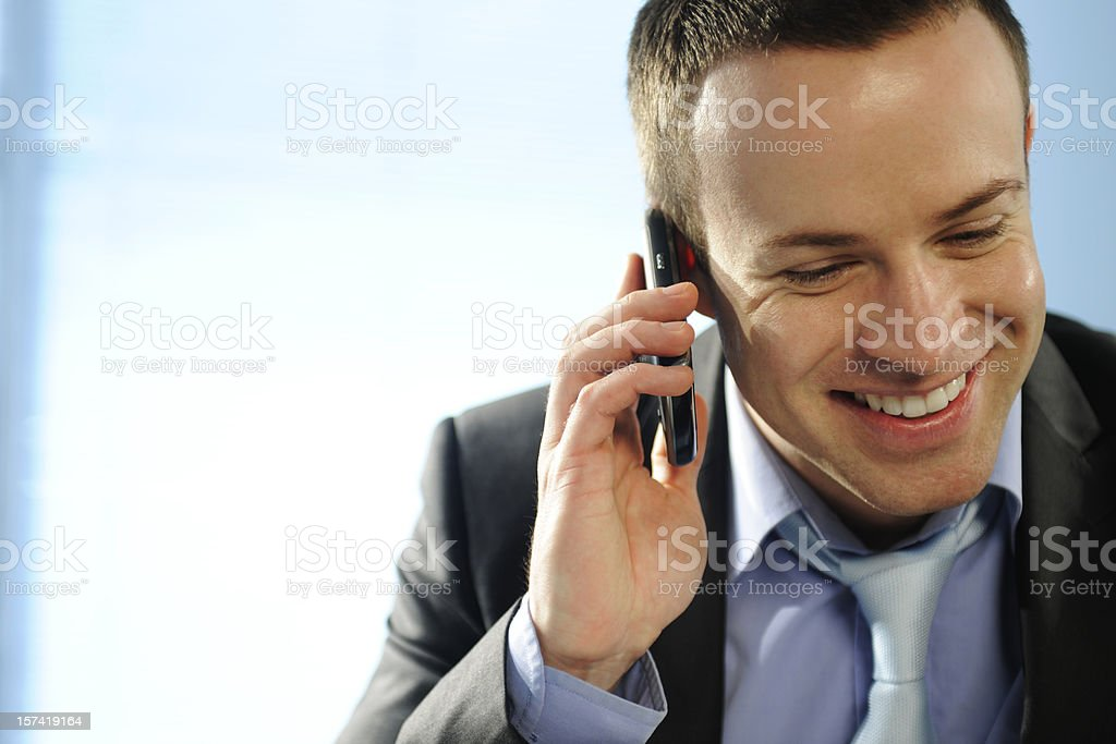 Happy Business Man Speaking on Mobile Phone royalty-free stock photo