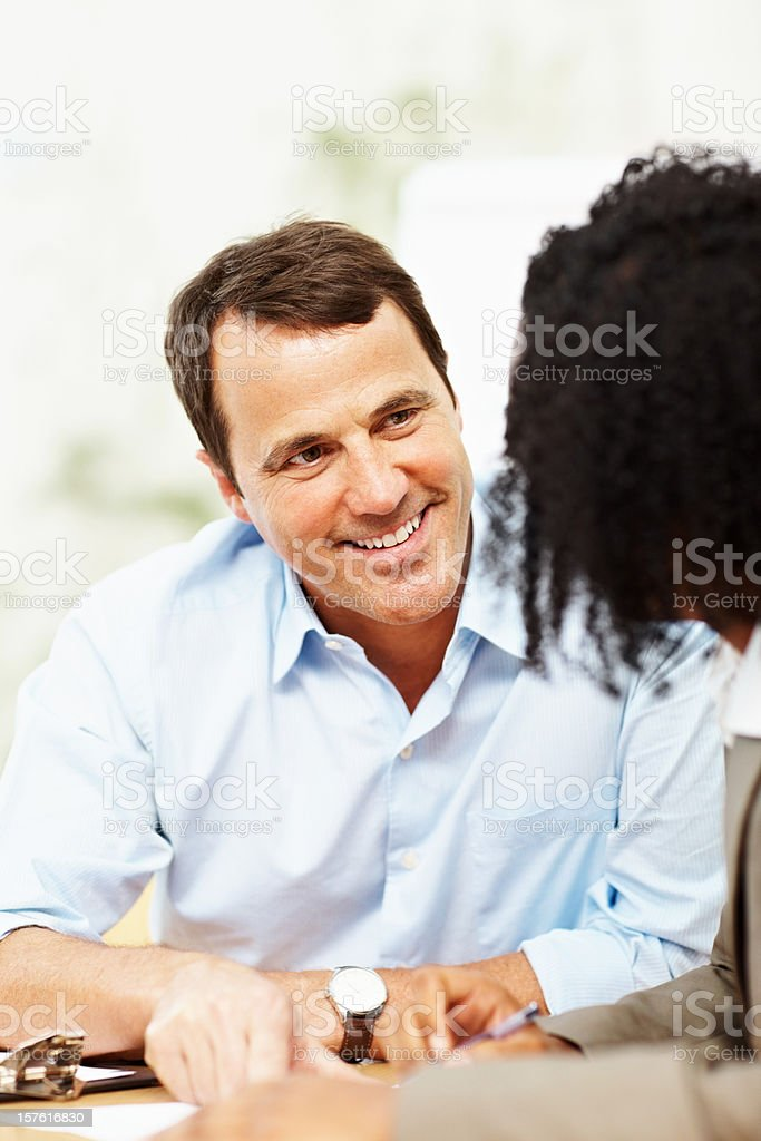 Happy business man speaking to a colleague royalty-free stock photo