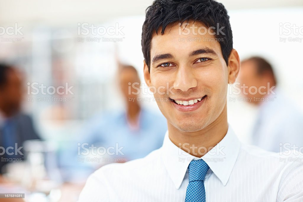 Happy business man with colleagues at the back royalty-free stock photo