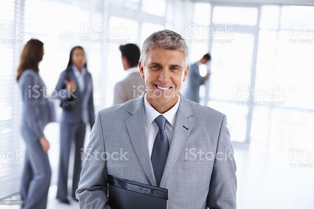 Happy business man with file folder at office royalty-free stock photo