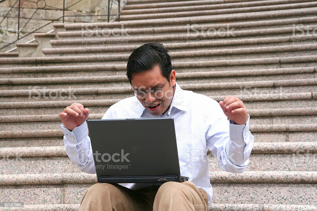 happy business man with his laptop stock photo