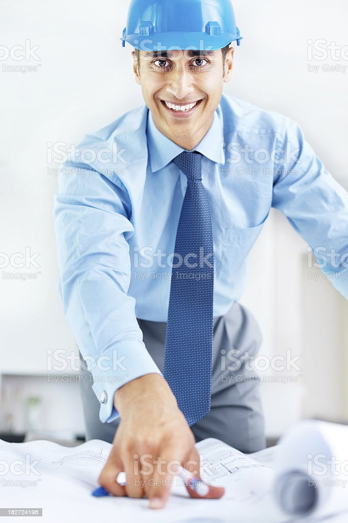 Happy business man working on blue prints royalty-free stock photo