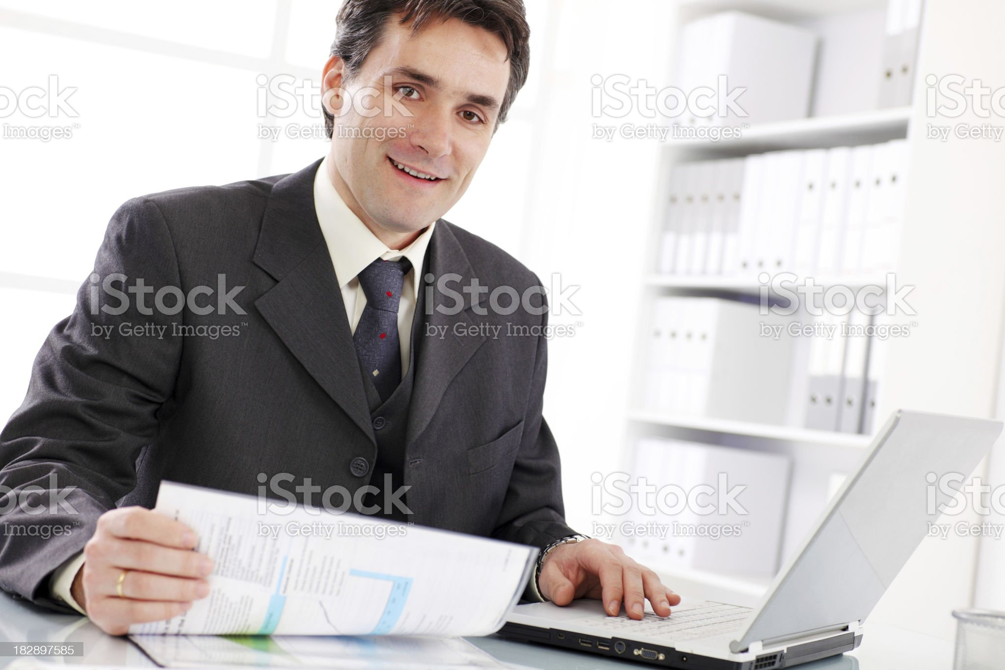Happy business man working on laptop. royalty-free stock photo