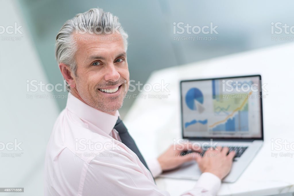 Happy business man working online stock photo