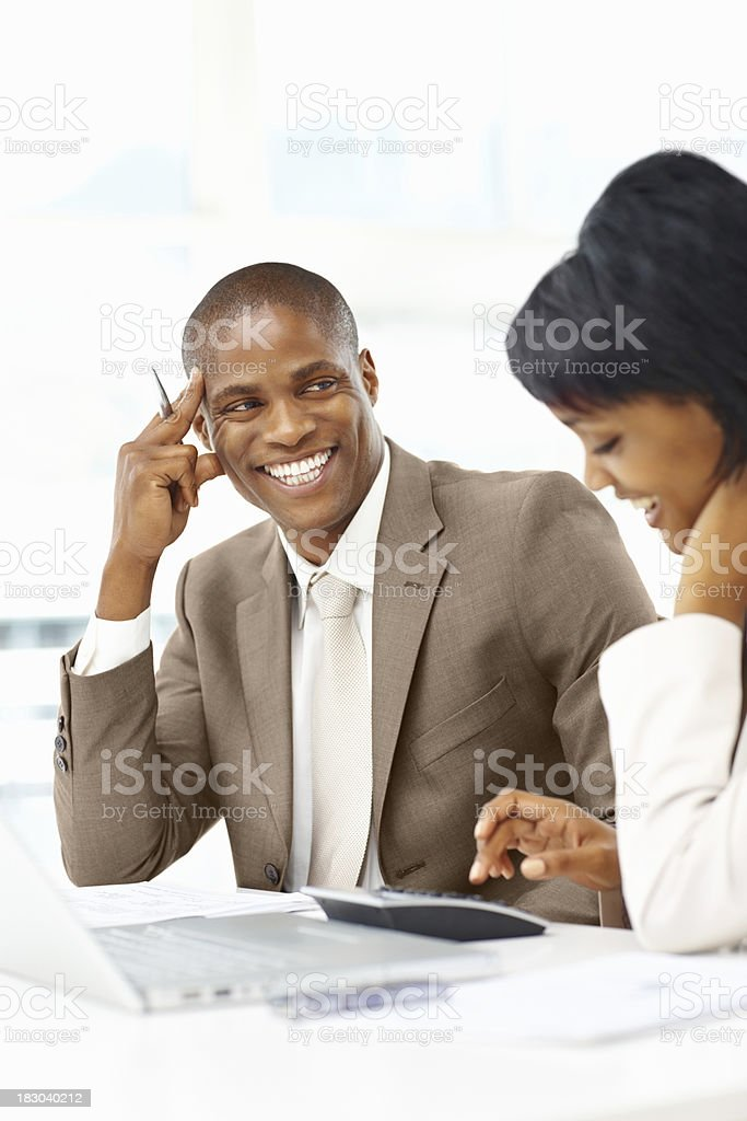 Happy business man working with a woman at office royalty-free stock photo