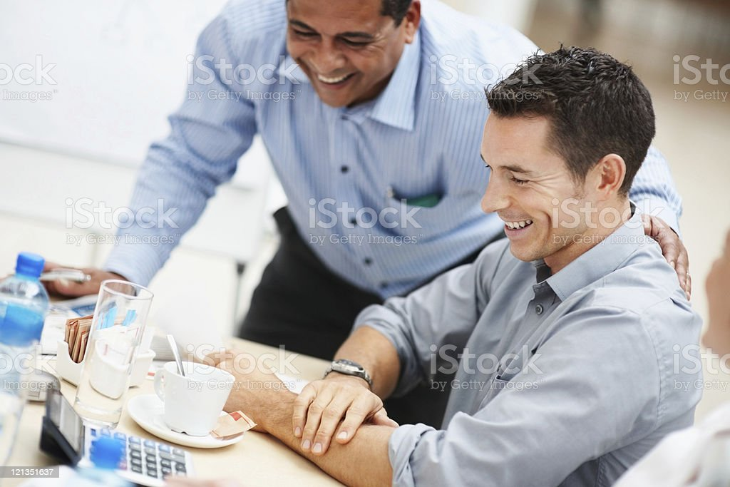 Happy business men having a good time at work royalty-free stock photo