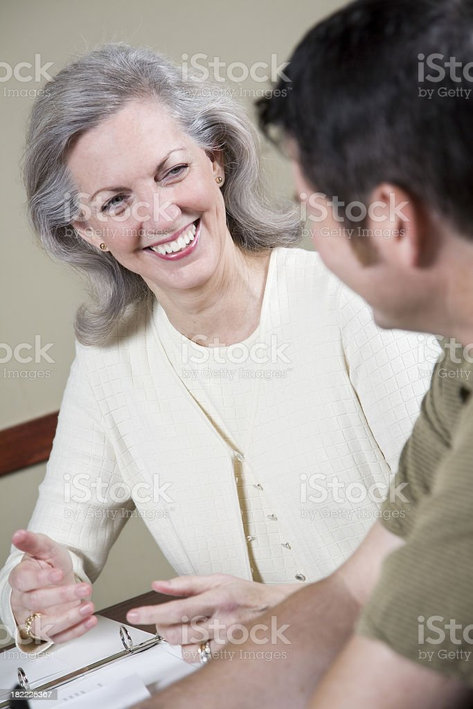 Happy Business Partner Explaining Something to Coworker royalty-free stock photo