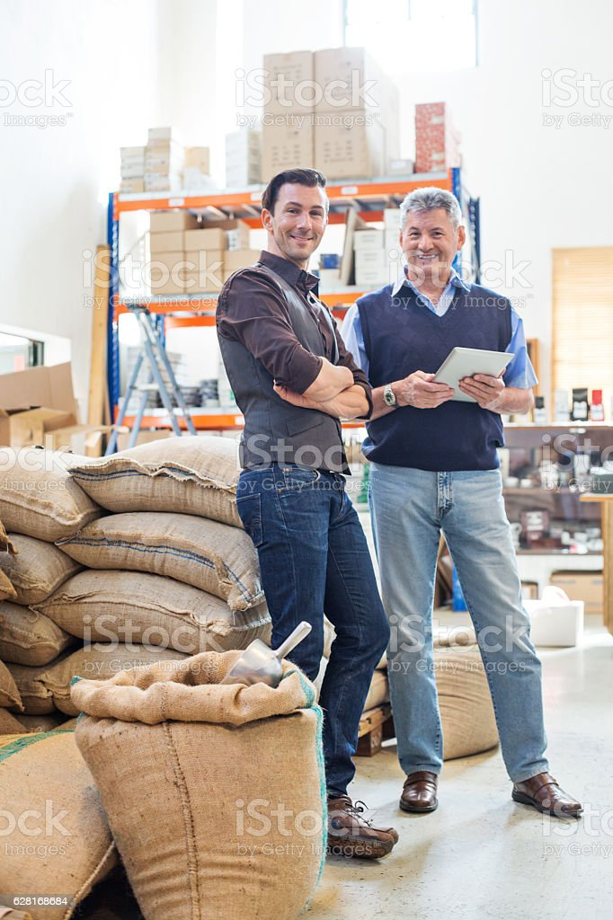 Happy business partners at coffee storage room stock photo