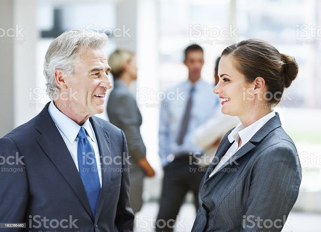 Happy business people and their team in blur background royalty-free stock photo