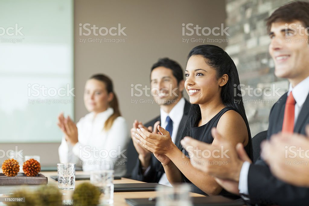 Happy business people clapping royalty-free stock photo