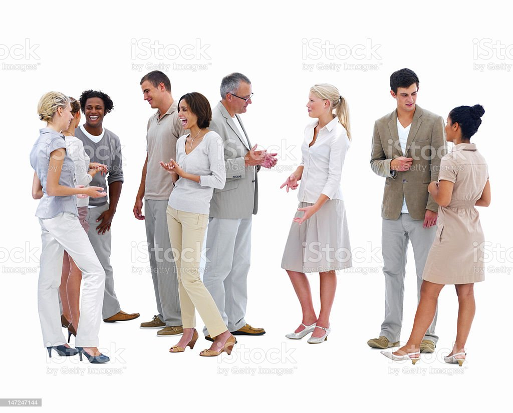 Happy business people conversing with each other stock photo
