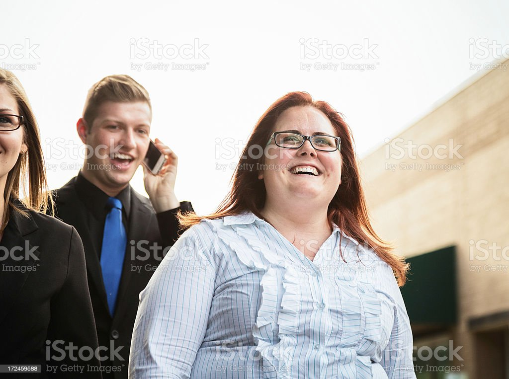 Happy business people going to work royalty-free stock photo