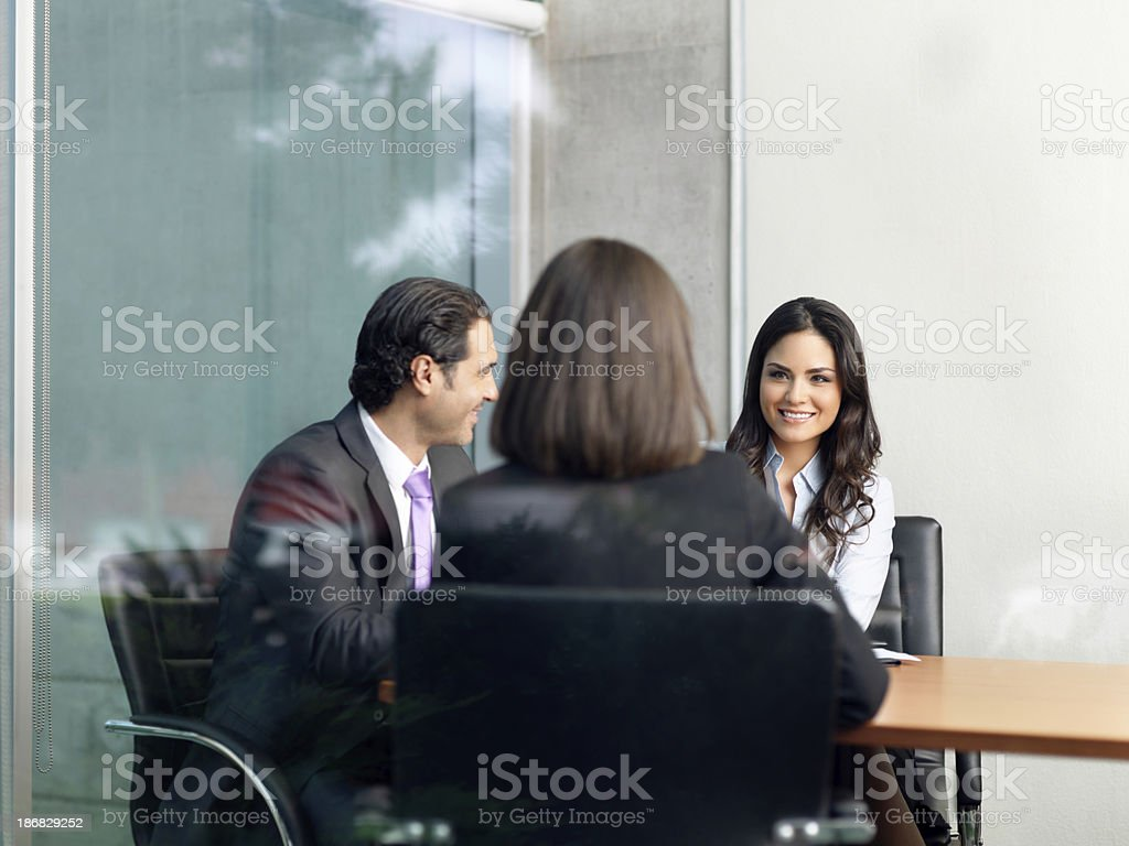 Happy business people in the office royalty-free stock photo