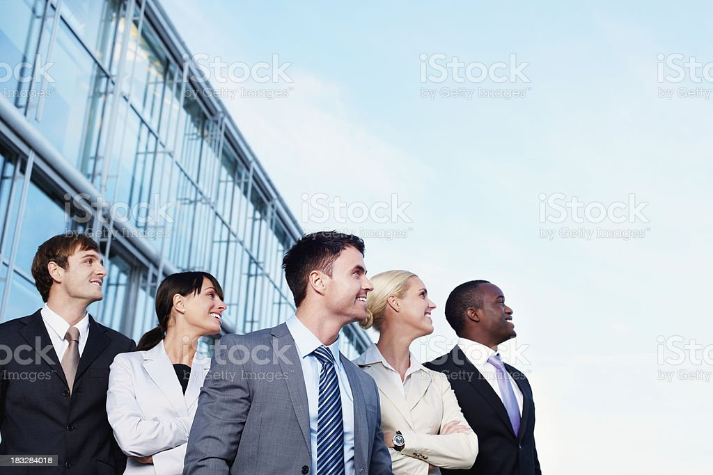 Happy business people looking to the side - copyspace royalty-free stock photo