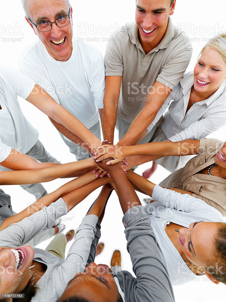 Happy business people showing unity royalty-free stock photo