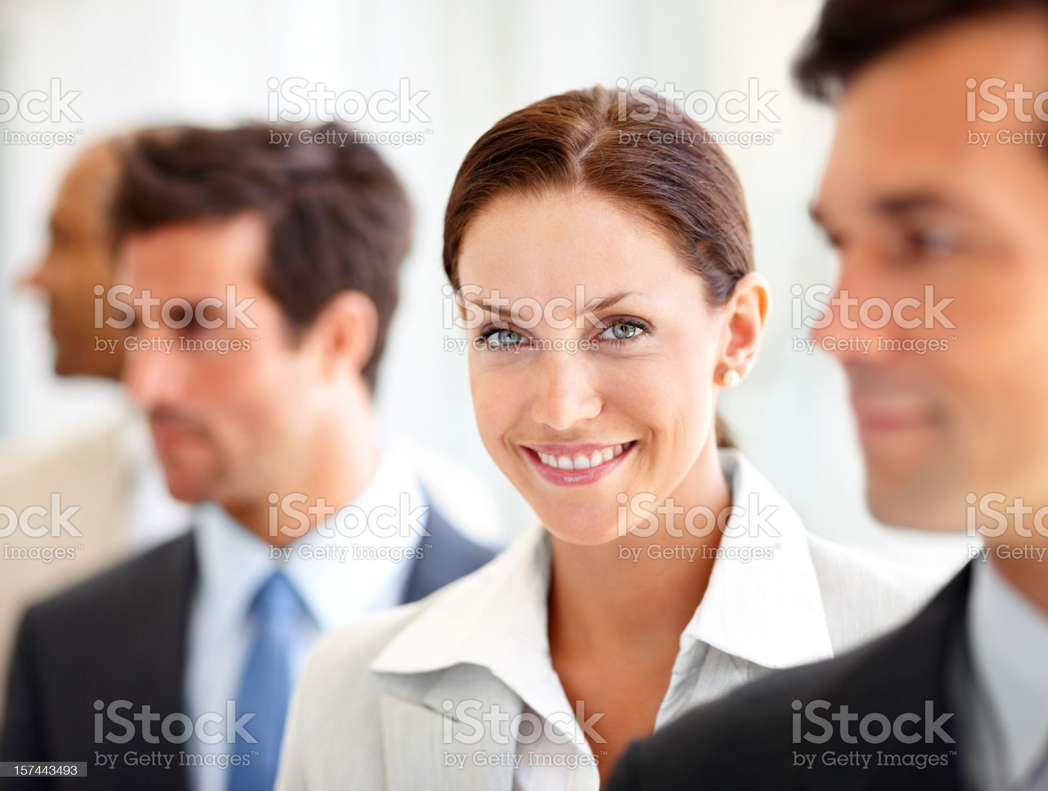Happy business people standing in a row royalty-free stock photo