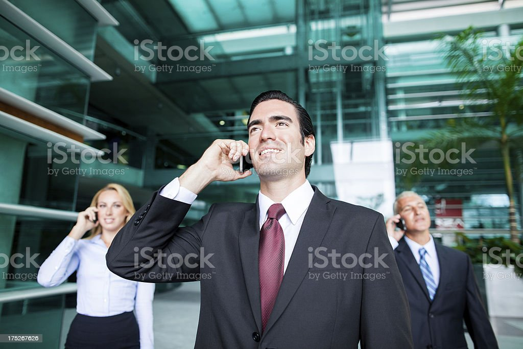 Happy business people talking on the phone royalty-free stock photo