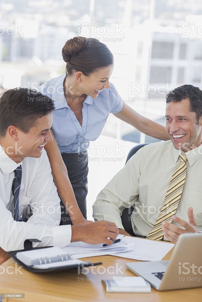 Happy business people working together and smiling royalty-free stock photo