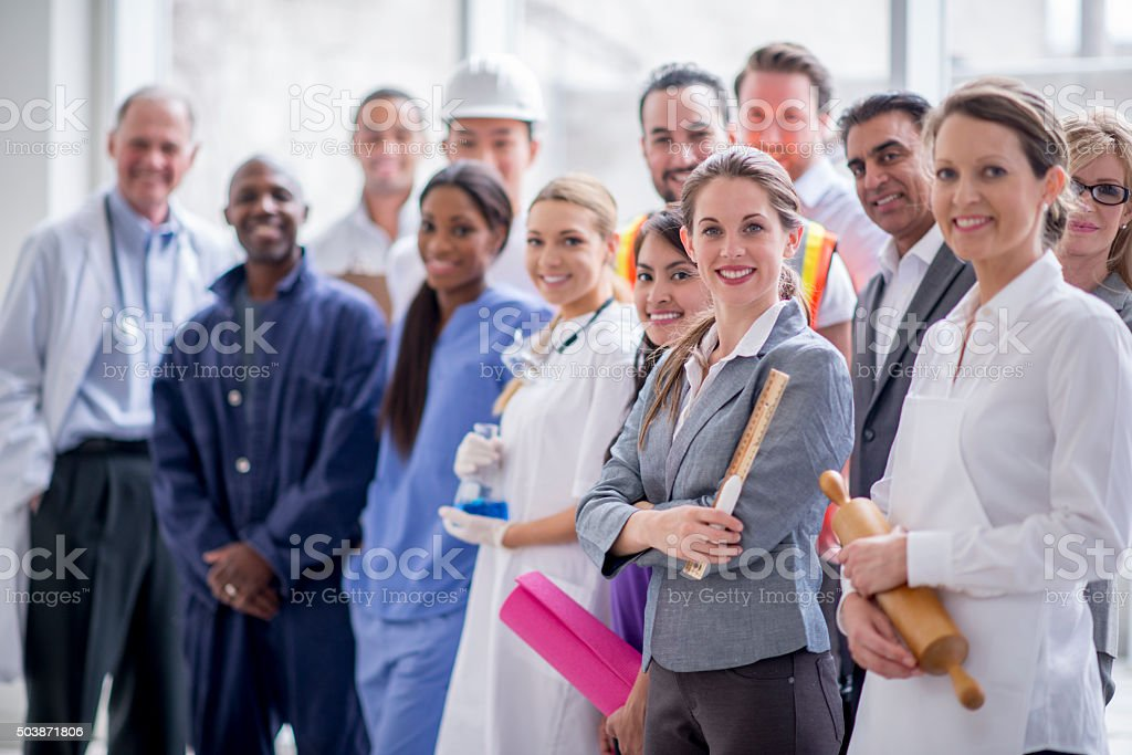 Happy Business Professionals Standing Together stock photo