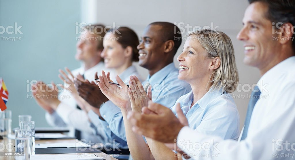Happy business team applauding royalty-free stock photo