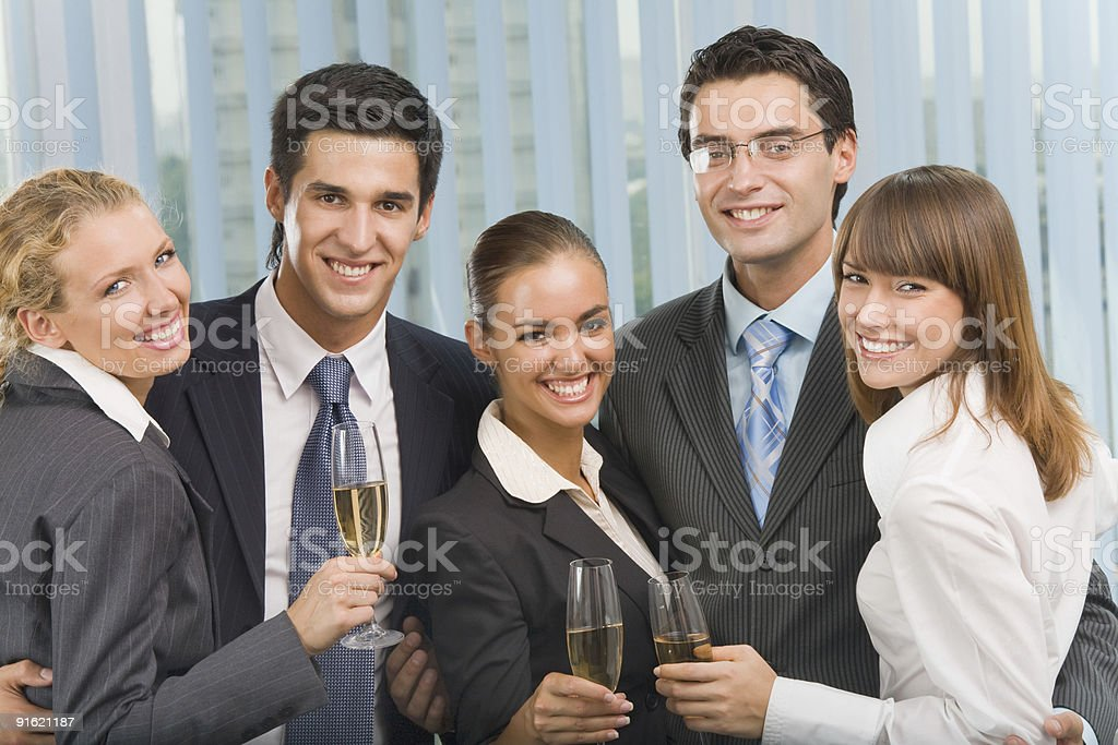 Happy business team celebrating with champagne at office royalty-free stock photo