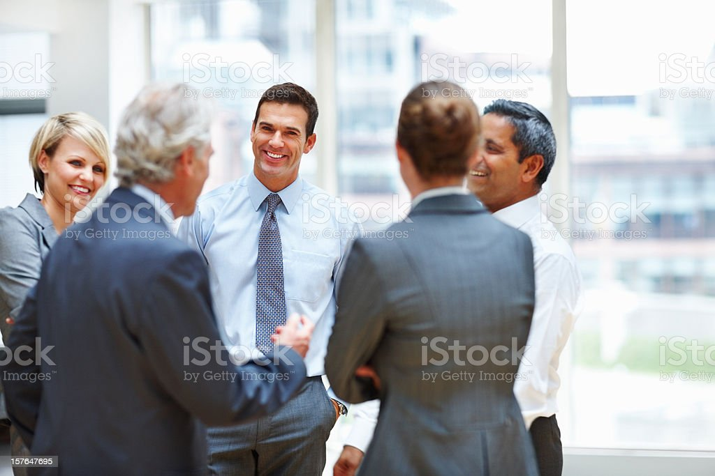 Happy business team in discussion at office royalty-free stock photo