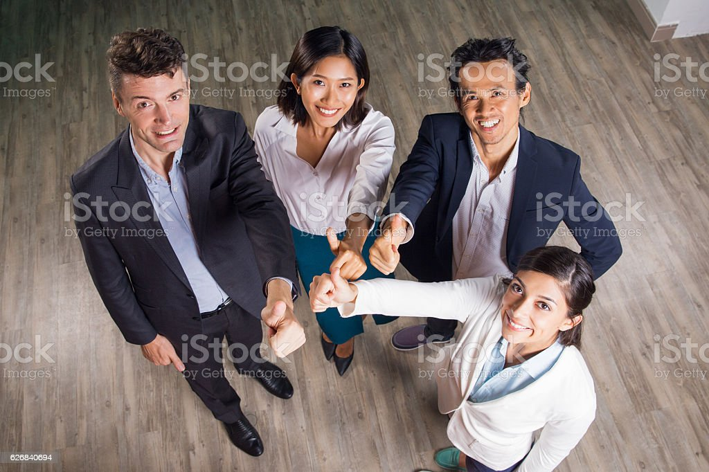 Happy Business Team Showing Thumbs up in Hall stock photo