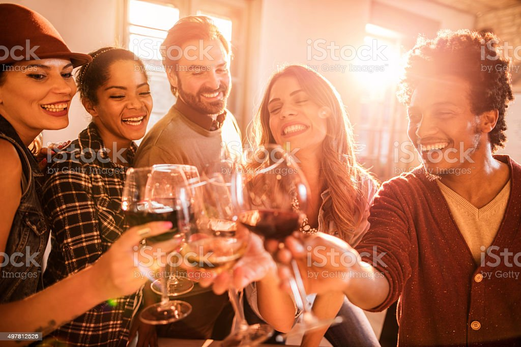 Happy business team toasting to their success at office. stock photo