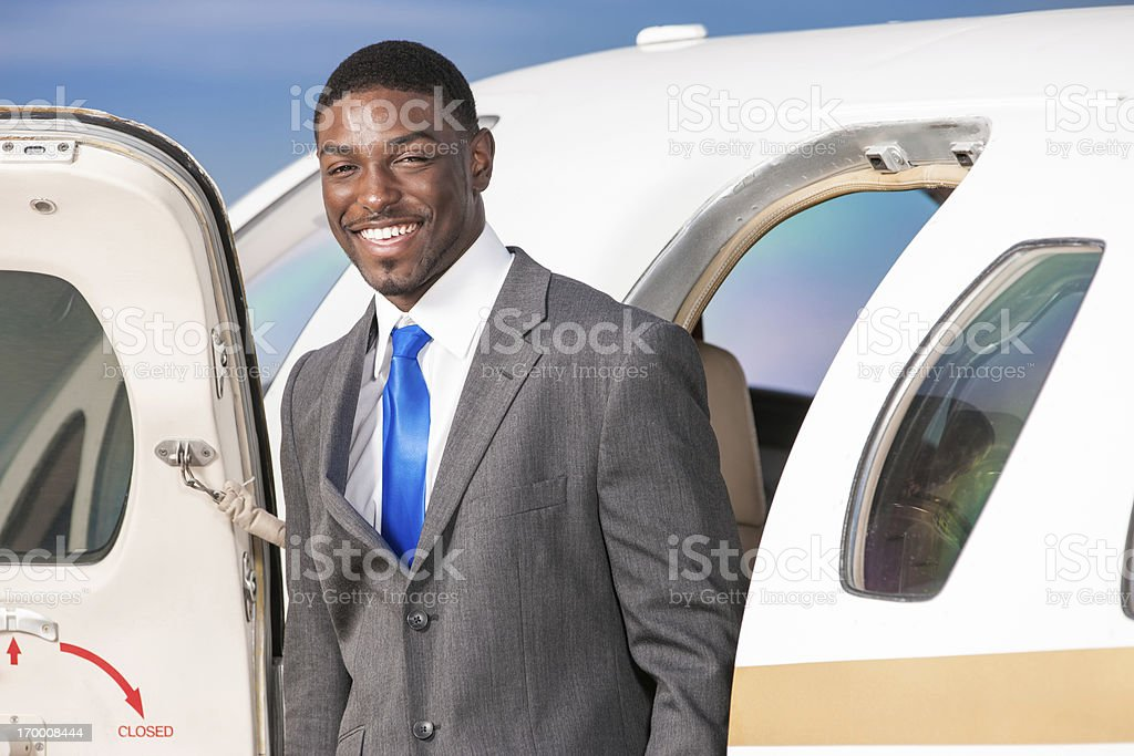 Happy Business Traveler in Doorway of Corporate Jet royalty-free stock photo