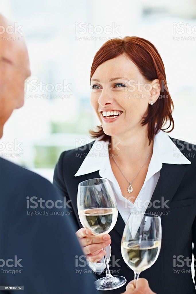 Happy business woman and man holding flute with champagne royalty-free stock photo