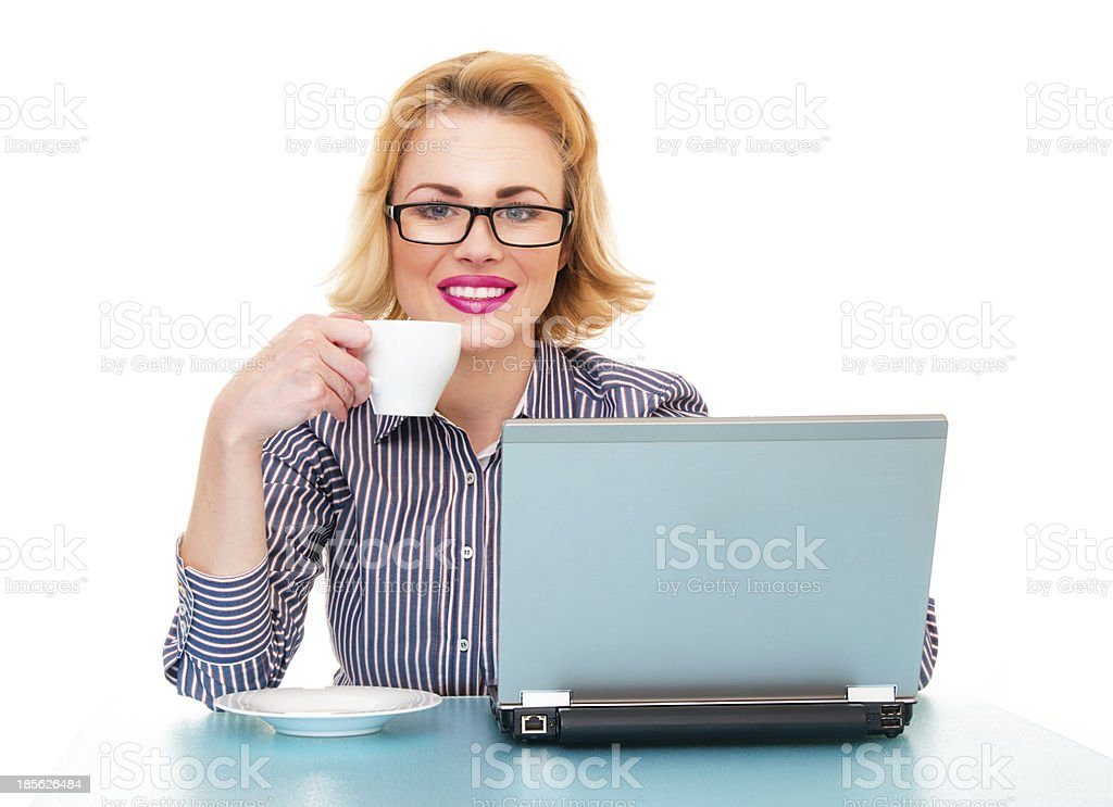 Happy business woman drinking coffee and watching in laptop royalty-free stock photo