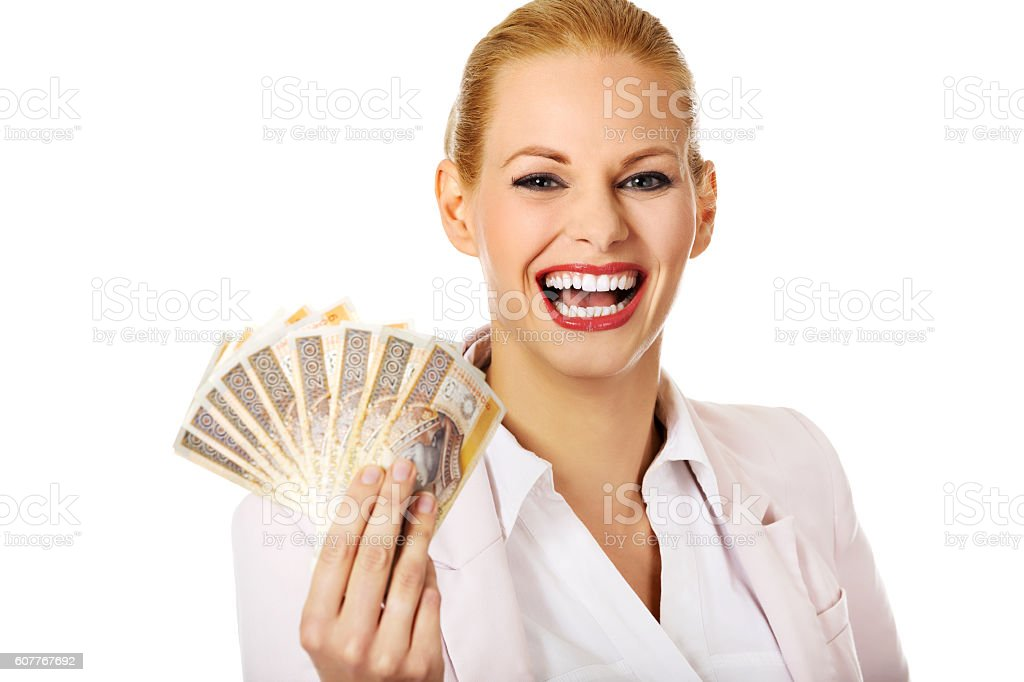 Happy business woman holding a clip of polish money stock photo