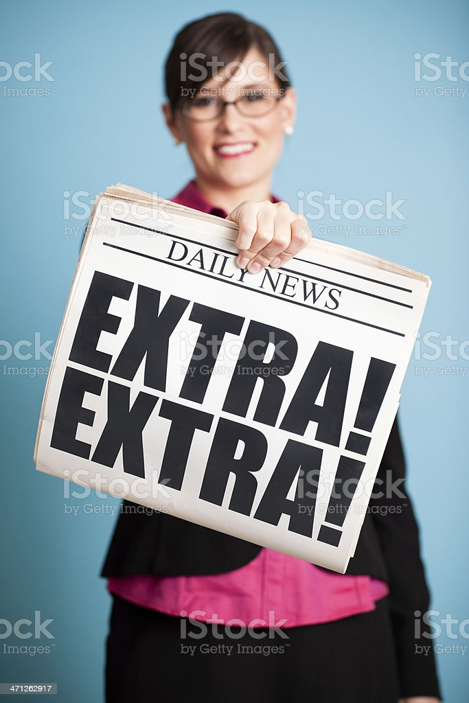 Happy Business Woman Holding Newspaper with Extra! Headline royalty-free stock photo