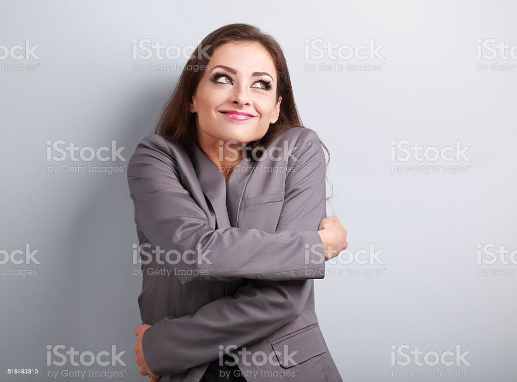 Happy business woman hugging herself with natural emotional enjo stock photo