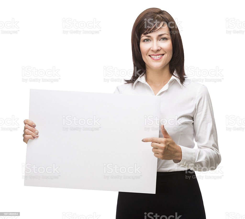 Happy business woman pointing at a sign royalty-free stock photo